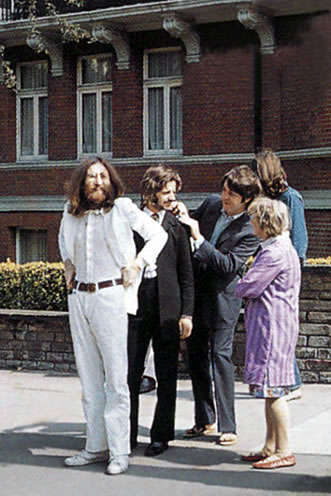 The Beatles on Abbey Road with unknown woman